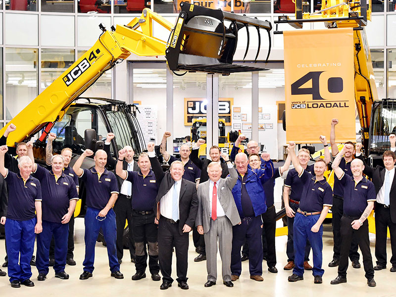 JCB Chairman Lord Bamford celebrating the Loadall with with staff